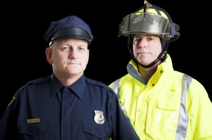 Police officer and Fireman picture used for The Law Office of Edward R. Scheine